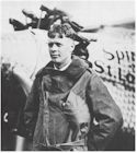 Charles Lindbergh poses with his famous plane